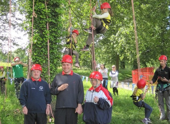 Picture of tree climbing Brownies and Special Olympics team members