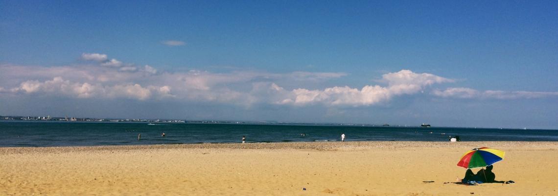 Love Ryde blog - Ryde beach, clouds, sand,sky, umbrella