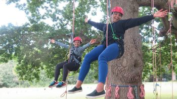 mum and child tree climbing